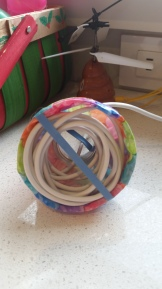 Rubber band to keep cord in place.